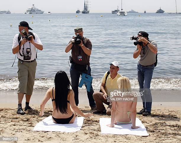 Hungarian model and actress Aletta Ocean and Czech actress Tarra White pose in bikini on the beach during a photocall on the sidelines of the 63rd...