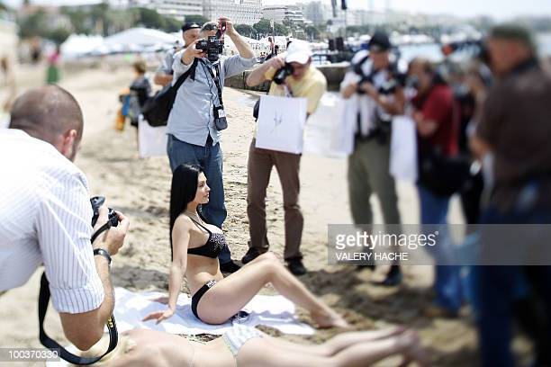Hungarian model and actress Aletta Ocean poses in bikini on the beach during a photocall on the sidelines of the 63rd Cannes Film Festival on May 18...
