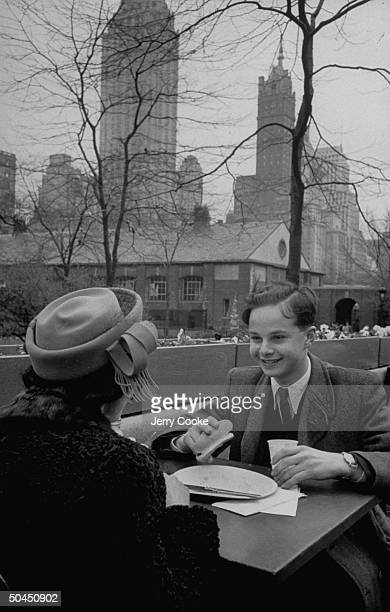 Hungarian musician Bruno Walter and his mother having lunch together