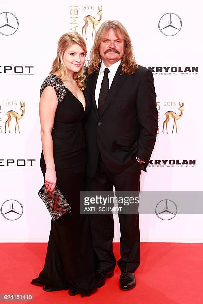 Hungarian musician Leslie Mandoki and his daughter Lara pose for photographers as they arrive at the Bambi awards on November 17 2016 in Berlin The...