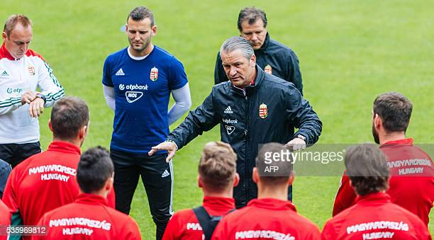 Hungarian national team coach Bernd Storck speaks to his players during a training session of Hungarian national football team in Leogang Austria on...