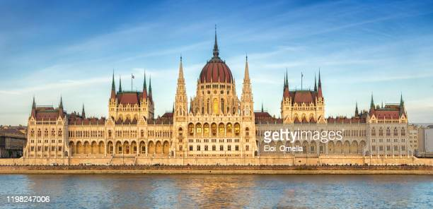 hungarian parliament at sunset, budapest - budapest stock pictures, royalty-free photos & images