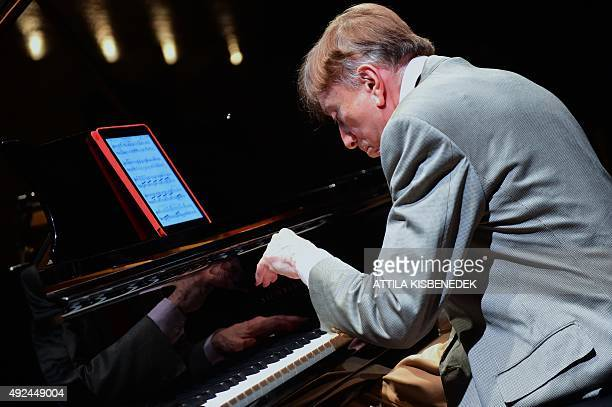 Hungarian pianist Tamas Vasary plays from a tablet with a sheet of a classical music in the concert hall of Budapest Music Center on October 13 2015...
