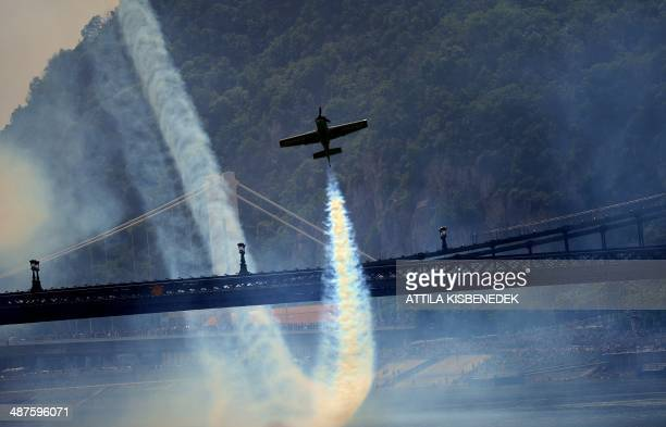 Hungarian pilot and European champion Zoltan Veres flies under the oldest Hungarian bridge the 'Lanchid' with his 'MXS' type plane on May 1 2014...