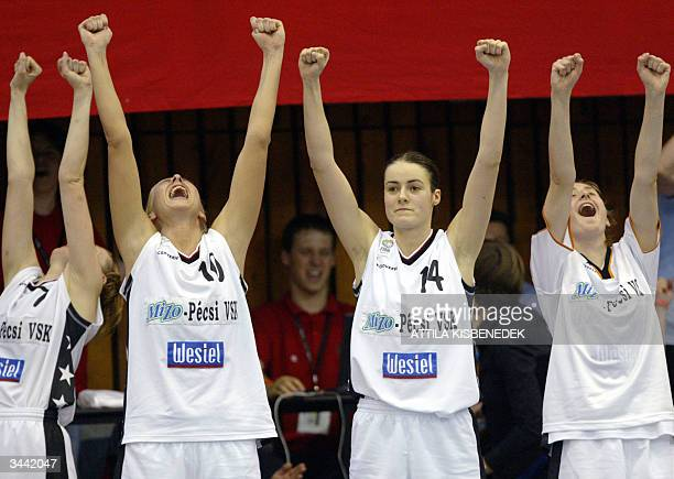 Hungarian players of MIZO Pecsi VSK Erzsebet Ambrus Annamaria Keller Ildiko Szakacs and Tunde Czukor celebrate their victory against Czech Gambrinus...