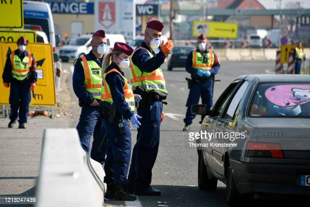 Hungarian police check cars at the AustrianHungarian border crossing in Nickelsdorf on March 18 2020 in Nickelsdorf Austria After negotiations...
