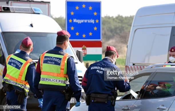 Hungarian police checks cars at the AustrianHungarian border crossing in Nickelsdorf on March 18 2020 in Nickelsdorf Austria After negotiations...