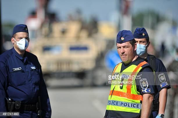 Hungarian police look on as migrants cross the CroatianHungarian border in village of Baranjsko Petrovo Selo near NorthEastern Croatian town of Beli...