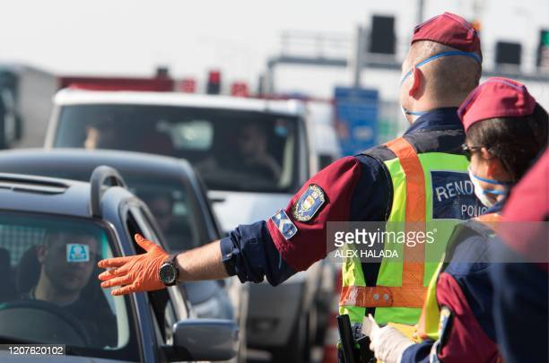 Hungarian police officers check cars at the NickelsdorfHegyeshalom border crossing on the AustrianHungarian border on March 18 2020 Hungary's closure...