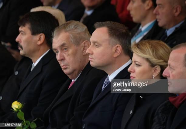 Hungarian President Janos Ader Czech President Milos Zeman Polish President Andrzej Duda and Slovak President Zuzana Caputova attend a ceremony to...