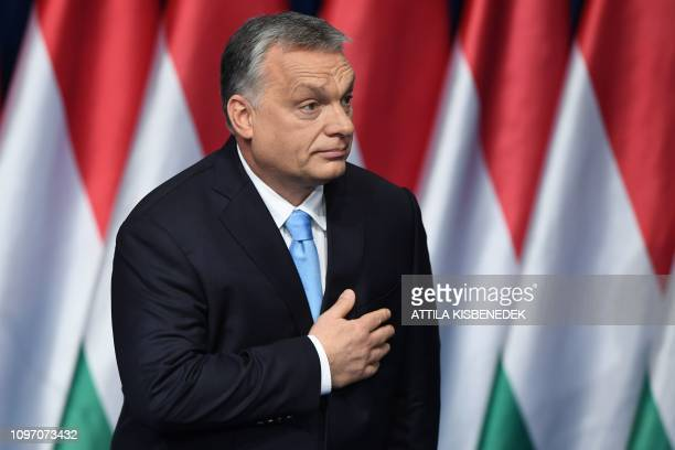Hungarian Prime Minister and Chairman of FIDESZ party Viktor Orban reacts after delivering his state of the nation speech in front of his party...