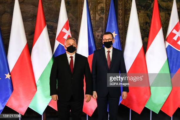 Hungarian Prime Minister Victor Orban and Polish Prime Minister Mateusz Morawiecki seen posing for a photo during the official start of the 30th...