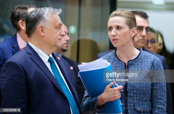 Hungarian Prime Minister Viktor Mihaly Orban talks with the Danish Prime Minister Mette Frederiksen during a special European Council summit on...