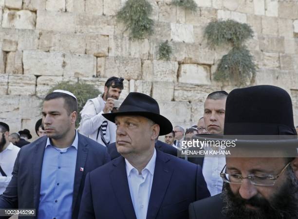 Hungarian Prime Minister Viktor Orban accompanied by Rabbi of the Western Wall Shmuel Rabinovitch visits the Western Wall in Jerusalem's Old City on...