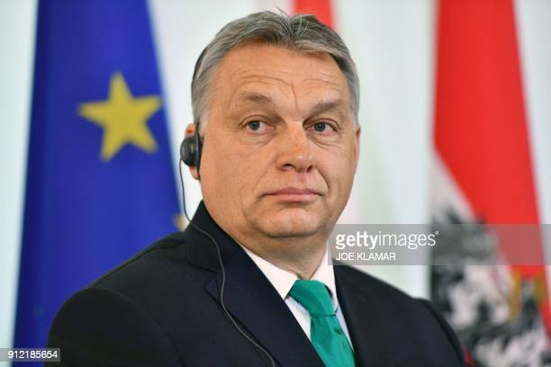 Hungarian Prime Minister Viktor Orban addreses a press conference with his Austrian counterpart at the Chancellery in Vienna on January 30 2018 / AFP...