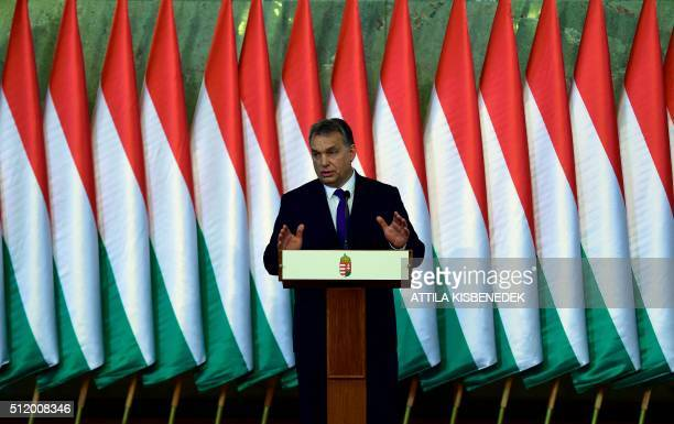 Hungarian Prime Minister Viktor Orban addresses a press conference at the Delegation Hall of the parliament building in Budapest on February 24 2016...