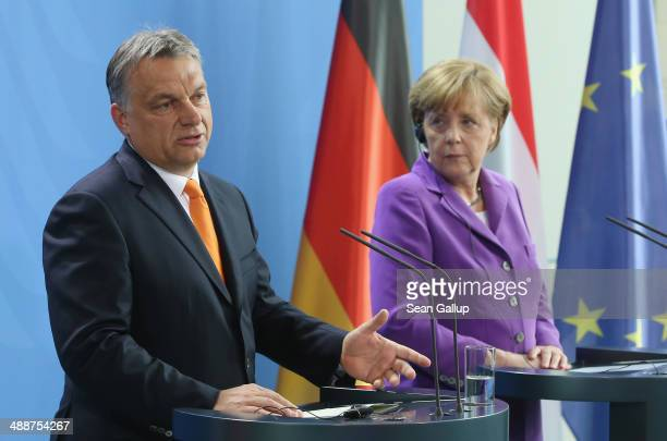 Hungarian Prime Minister Viktor Orban and German Chancellor Angela Merkel speak to the media prior to talks at the Chancellery on May 8 2014 in...