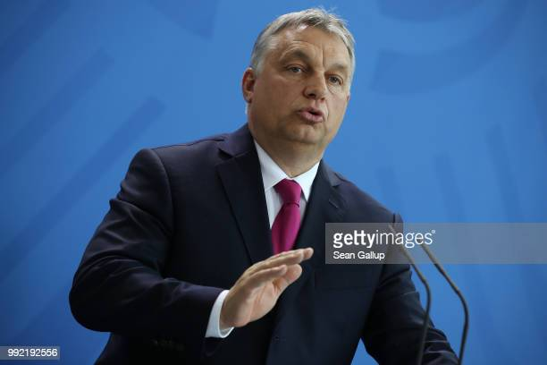 Hungarian Prime Minister Viktor Orban and German Chancellor Angela Merkel speak to the media following talks at the Chancellery on July 5 2018 in...