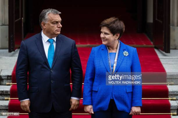 Hungarian Prime Minister Viktor Orban and his Polish counterpart Beata Szydlo attend a welcoming ceremony prior to their meeting in Warsaw on...
