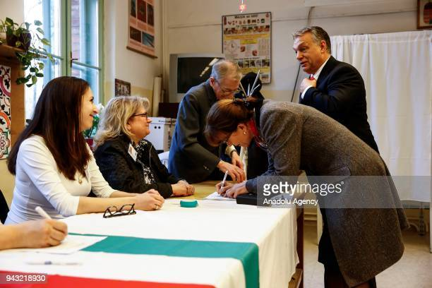 Hungarian Prime Minister Viktor Orban and his wife Aniko Levai cast their votes during Hungarian parliamentary election at a polling station in...