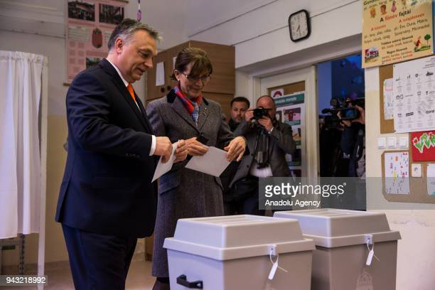Hungarian Prime Minister Viktor Orban and his wife Aniko Levai cast their ballots during Hungarian parliamentary election at a polling station in...