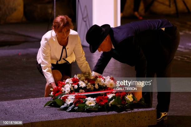 Hungarian Prime Minister Viktor Orban and his wife Aniko Levai lay a wreath at the Hall of Remembrance on July 19 2018 during their visit to the Yad...