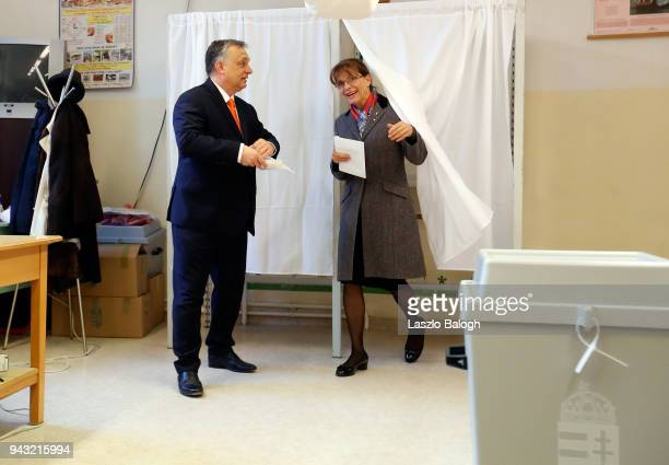 Hungarian Prime Minister Viktor Orban and his wife Aniko Levai leave the polling booth to cast his ballot on April 8 in Budapest Hungary Hungary hold...