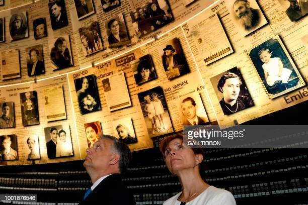 Hungarian Prime Minister Viktor Orban and his wife Aniko Levai look at pictures of Jewish Holocaust victims at the Hall of Names on July 19 2018...