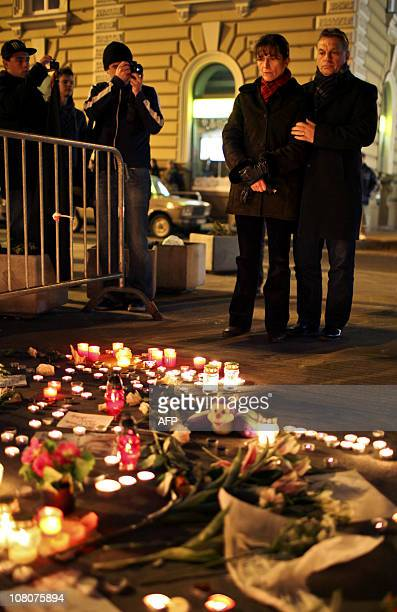 Hungarian Prime Minister Viktor Orban and his wife Aniko Levai stand after Hungarian citizens and teenagers light candles in front of the West Balkan...