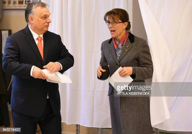Hungarian Prime Minister Viktor Orban and his wife Aniko Levai vote at a polling station located ina school in Budapest on April 8 2018 Hungary votes...