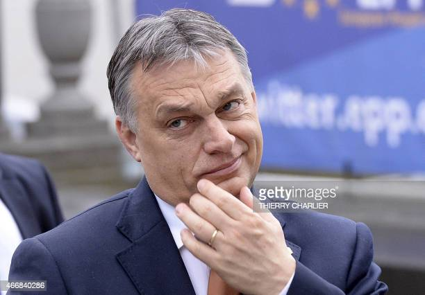 Hungarian Prime Minister Viktor Orban arrives for an European People's Party meeting ahead of a European leaders summit in Brussels on March 19 2015...