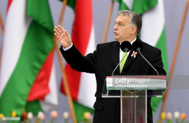 Hungarian Prime Minister Viktor Orban delivers a speech in front of the Hungarian Parliament in Budapest on March 15 during the official...