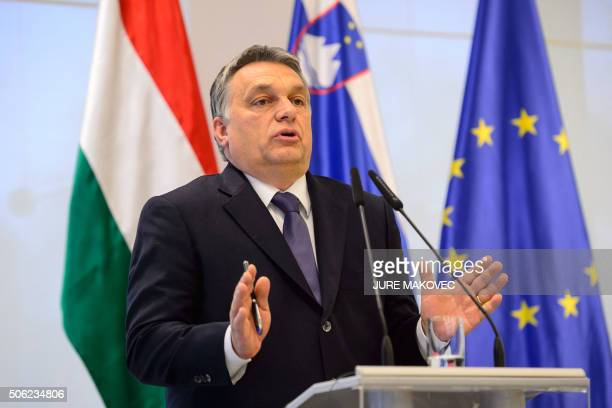 Hungarian Prime Minister Viktor Orban gestures as he speaks during a press conference after meeting with his Slovenian counterpart in Brdo, near...
