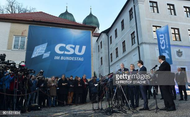 Hungarian Prime Minister Viktor Orban is flanked by the leader of the Christian Social Union Horst Seehofer and German Transport Minister Alexander...
