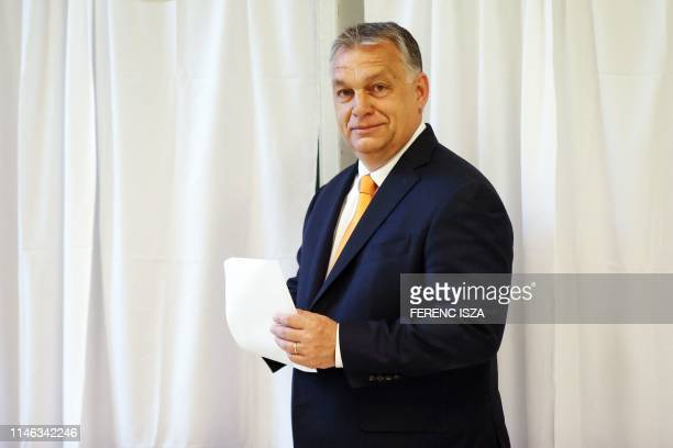 Hungarian Prime Minister Viktor Orban poses before casting his vote for the European elections at a polling station in the XII district of Hungarian...