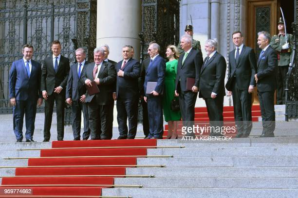 Hungarian Prime Minister Viktor Orban poses for a family picture with members of his fourth cabinet before taking oath of office on May 2018 in front...