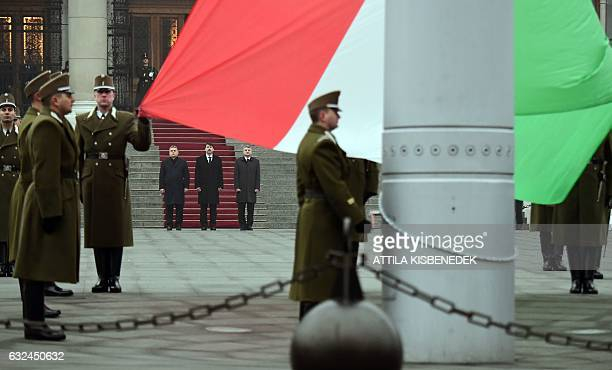 Hungarian Prime Minister Viktor Orban, President Janos Ader and Speaker of the Parliament Laszlo Kover stand behind the Hungarian flag in front of...