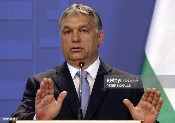 Hungarian Prime Minister Viktor Orban reacts during a joint press conference with the Austrian Chancellor in the Delegation Hall of the parliament...