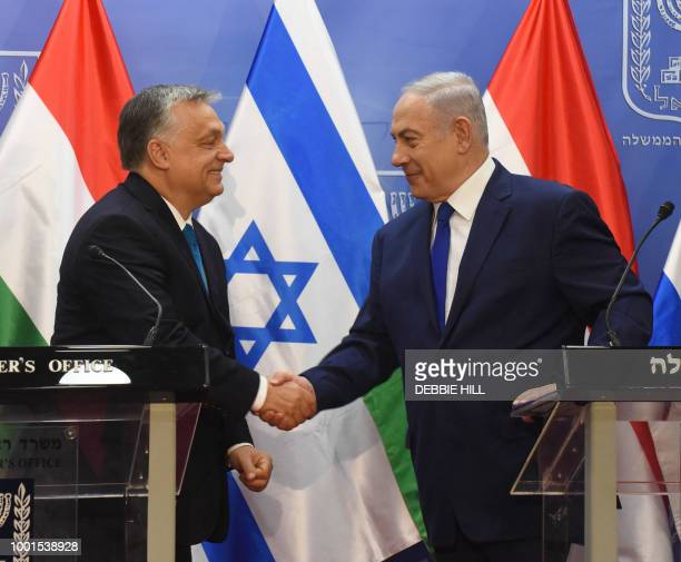 Hungarian Prime Minister Viktor Orban shake hands with Israeli Prime Minister Benjamin Netanyahu on during joint statements at the prime minister's...