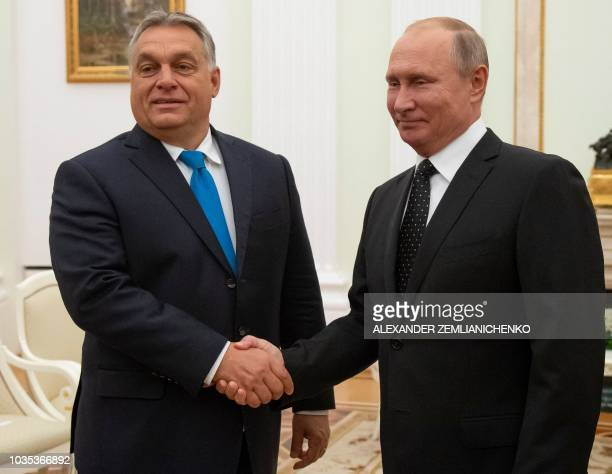 Hungarian Prime Minister Viktor Orban shakes hands with Russian President Vladimir Putin during their meeting in the Kremlin in Moscow on September...