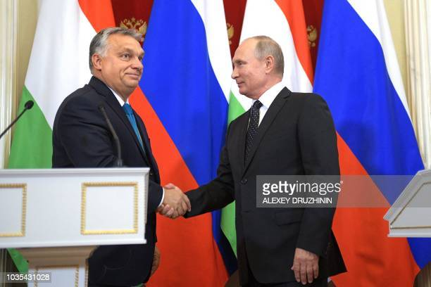 Hungarian Prime Minister Viktor Orban shakes hands with Russian President Vladimir Putin during their joint press conference following their meeting...