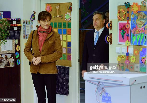 Hungarian Prime Minister Viktor Orban steps into the polling station with his wife Aniko Levai at a local school at12th district of Budapest on April...