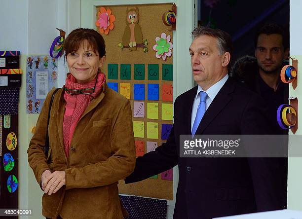 Hungarian Prime Minister Viktor Orban steps into the polling station with his wife Aniko Levai at a local school at 12th district of Budapest on...