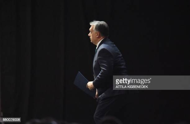 Hungarian Prime Minister Viktor Orban steps on the podium to give a speech during an economic forum attended by 15 central and eastern European...