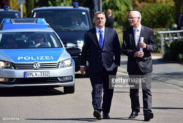 Hungarian Prime Minister Viktor Orban walks to the media after his visit to the former German Chancellor Helmut Kohl at Kohl's villa in Oggersheim on...