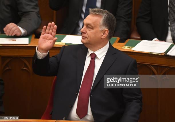 Hungarian Prime Minister Viktor Orban waves prior to a swearingin ceremony for members of the new Hungarian parliament on May 8 2018 during the...