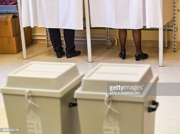 Hungarian Prime Minister Viktor Orban's and his wife Aniko Levai's feet are seen in a polling booth as they cast their votes at a school in Budapest...