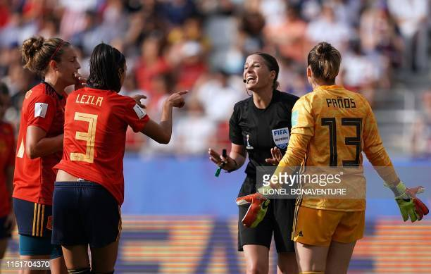 TOPSHOT Hungarian referee Katalin Kulcsar argues with Spain's defender Leila Ouahabi and Spain's goalkeeper Sandra Panos after giving a penalty kick...