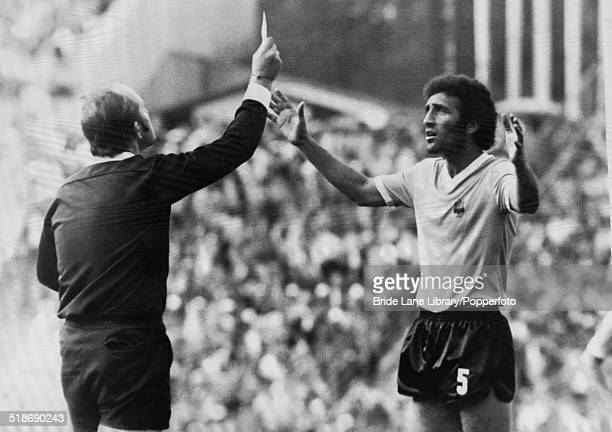 Hungarian referee Károly Palotai shows the red card to Uruguayan defender Julio Montero Castillo after his third foul during the World Cup Group 3...
