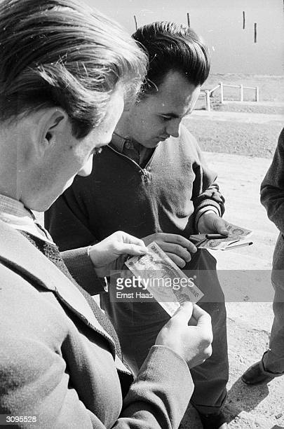 Hungarian refugees counting their currency in postwar Vienna